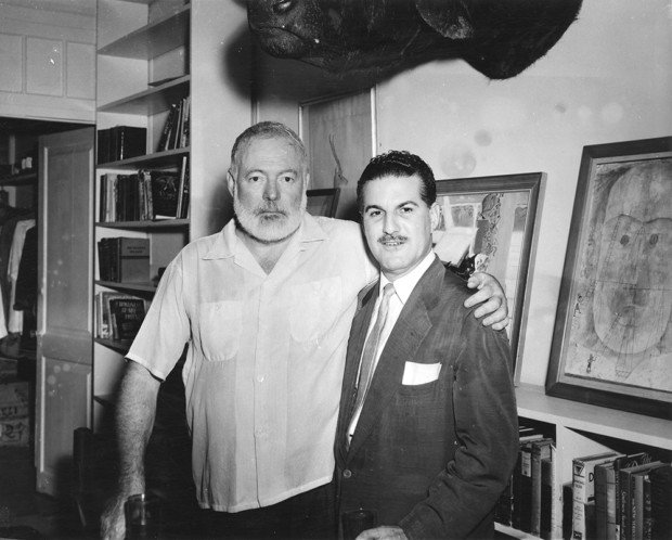 "Ernest Hemingway and Fernando Campoamor (local Cuban journalist) at Finca Vigia. Pictured behind them on the far right is a painting by Paul Klee titled ""Monument Under Construction"". Source: J.F.K. Library, Boston"