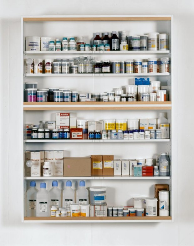 Damien Hirst Holidays 1989 Glass, faced particleboard, ramin, plastic, aluminium and pharmaceutical packaging 1372 x 1016 x 229 mm   54 x 40 x 9 in Sculpture Medicine Cabinets Damien Hirst, Holidays, 1989, Image: Photographed by Joanna Fernandes © Damien Hirst and Science