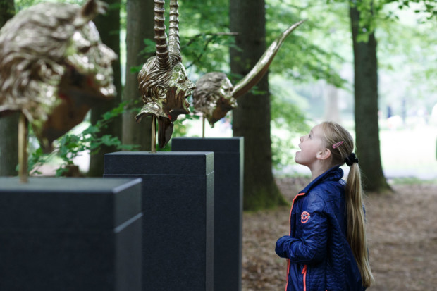 Girl with 'Chapters' by Jan Fabre. Photo Wieneke Hofland