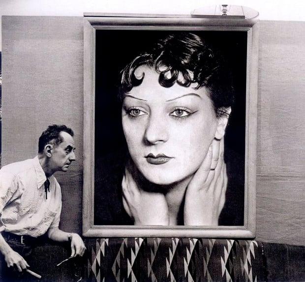 Kiki de Montparnasse Man Ray in front of the portrait of Kiki, 1930s / Michel Sima