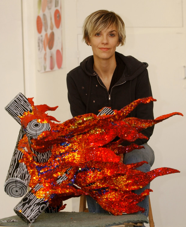 "John Hayes, Liza Lou sits in her Fillmore, Calif. studio with ""flames,"" 2002 Liza Lou's art"