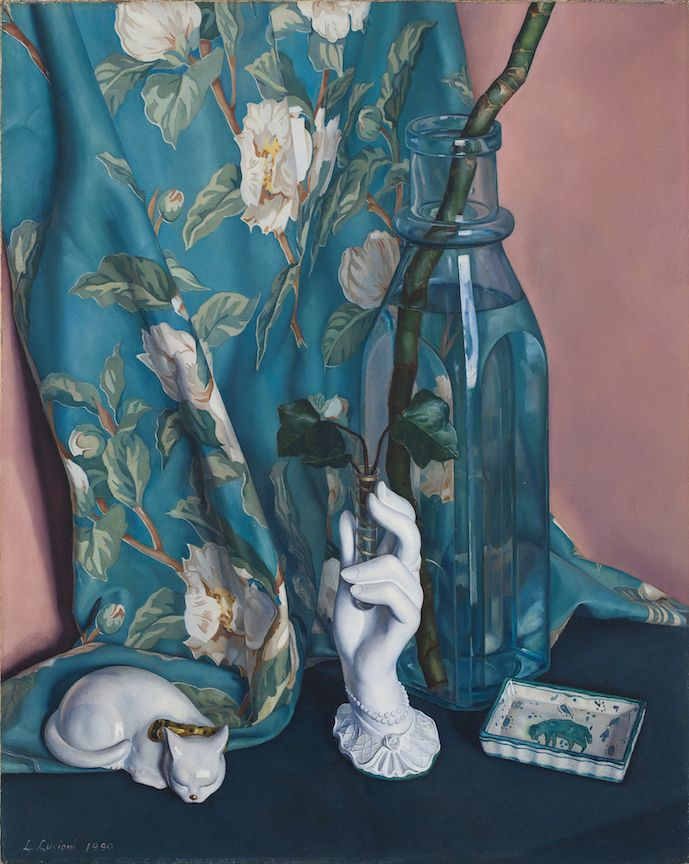 Luigi Lucioni's art Lucioni painting of a glass vase with bamboo, a porcelain hand, china cat, and rectangular dish arranged in front of a floral drape. Luigi Lucioni, Arrangement in Blue and White, 1940, DC Moore Gallery, New York, NY, USA.