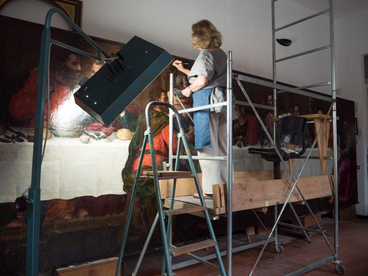 Conservator Rossella Lari on the scaffolding to restore Nelli's figures,restoration of last supper by Plautilla Nelli