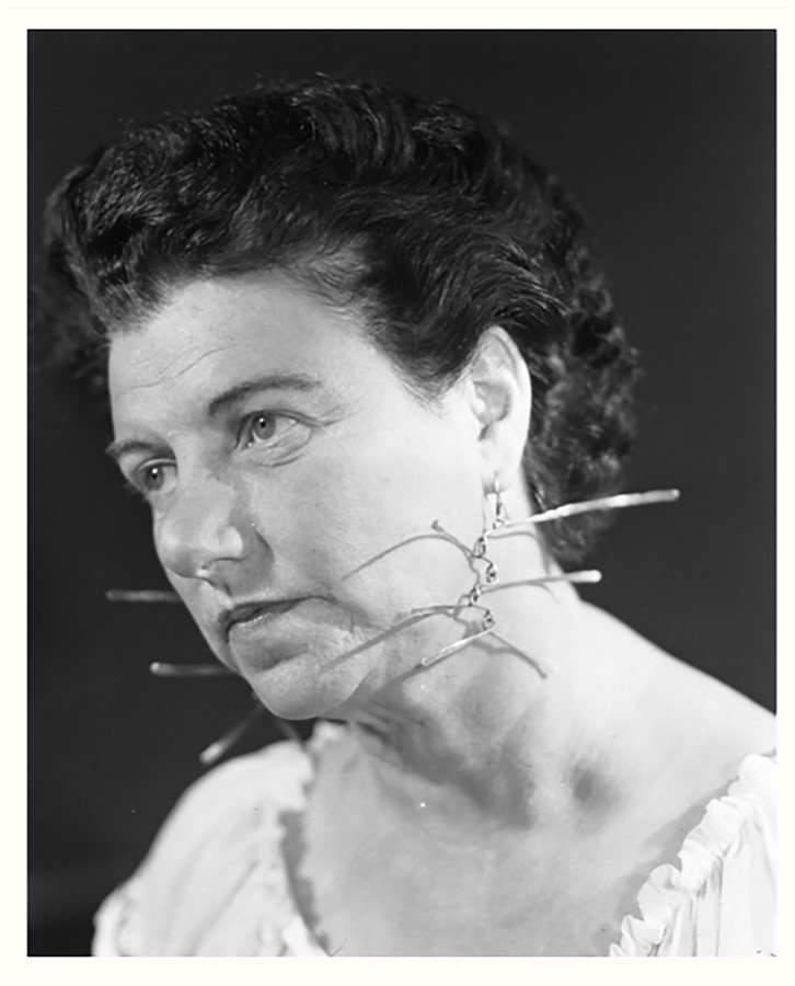 Peggy Guggenheim wearing earrings by Alexander Calder, 1942© Solomon R. Guggenheim Foundation, Photography © Archivo Cameraphotoepoche, Courtesy of The Calder Foundation, Calder's jewellery