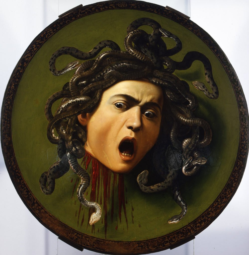 Top 10 Strange and Bizarre paintings: Caravaggio's beheaded Medusa painted on the surface of a shield.