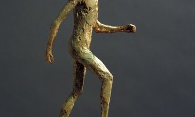 Elisabeth Frink 'Small Running Man' c.1986. Plaster and metal on plaster base. Tate Gallery, London. Image: Tate
