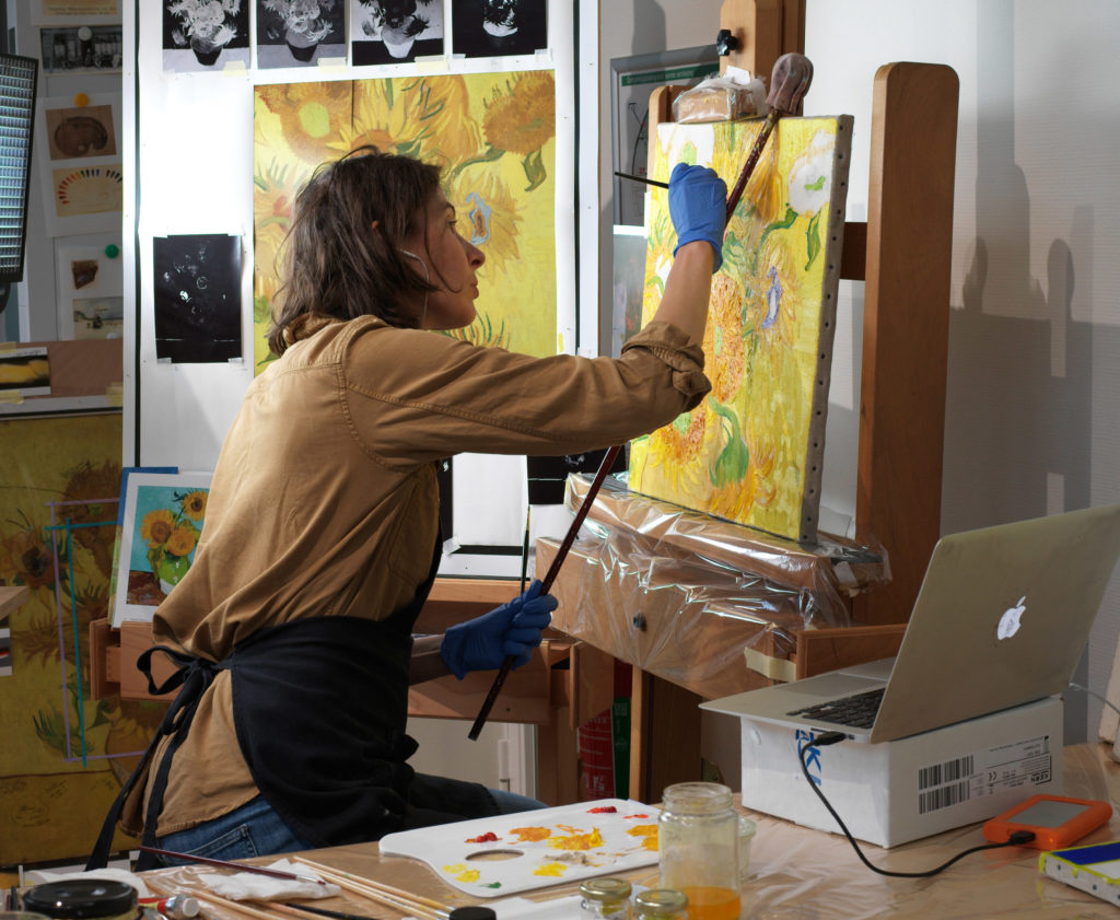 Artist Charlotte Caspers painted reconstructions based on the results of research into the original colours of Van Gogh's Sunflowers in the Van Gogh Museum, 2019