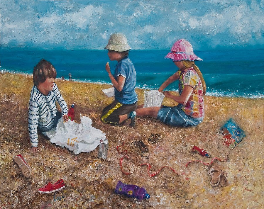Fish and Chips eaten at the seaside. Children play during the summer by the sea.
