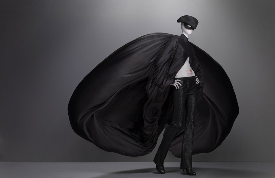 Alexander McQueen,  Supercalifragilisticexpialidocious collection, F/W 2002-3, Ensemble,  coat of black parachute silk; trouser of black synthetic; hat of black silk satin, hat by Philip Treacy for Alexander McQueen, Source: The Metropolitan Museum of Art, New York, USA.
