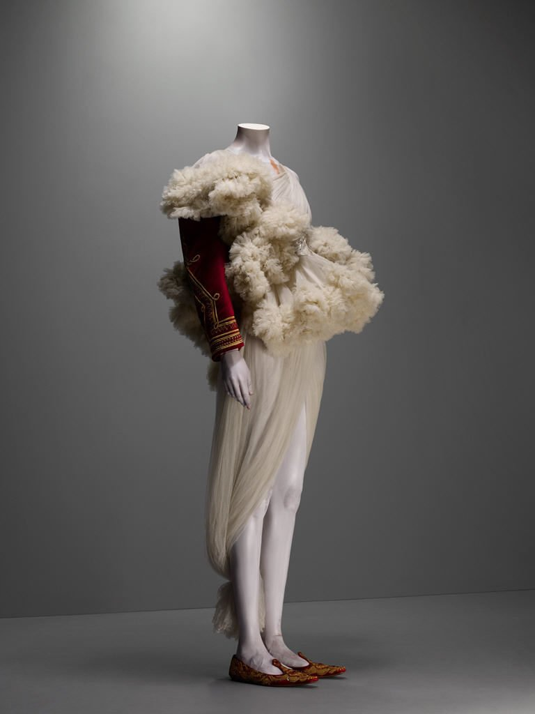 Alexander McQueen, The Girl Who Lived In A Tree collection, F/W 2008-9, Ensemble, jacket of red silk velvet embroidered with gold bullion and trimmed with white shearling; dress of ivory silk tulle, Source: The Metropolitan Museum of Art, New York, USA.