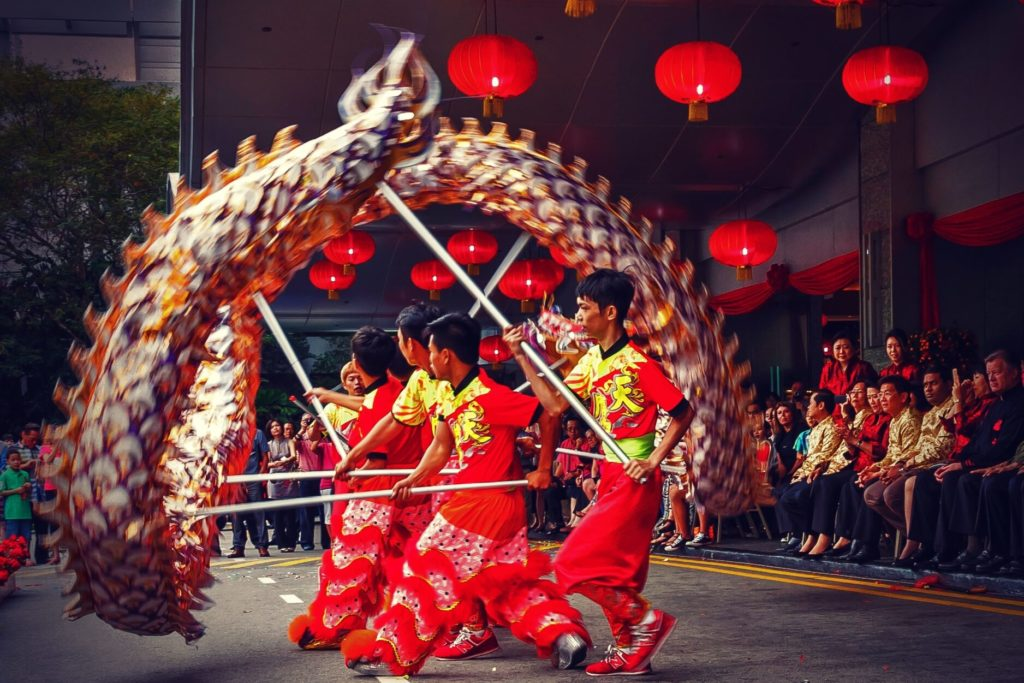 Several man perform a dragon dance during the Chinese New Year celebrations.