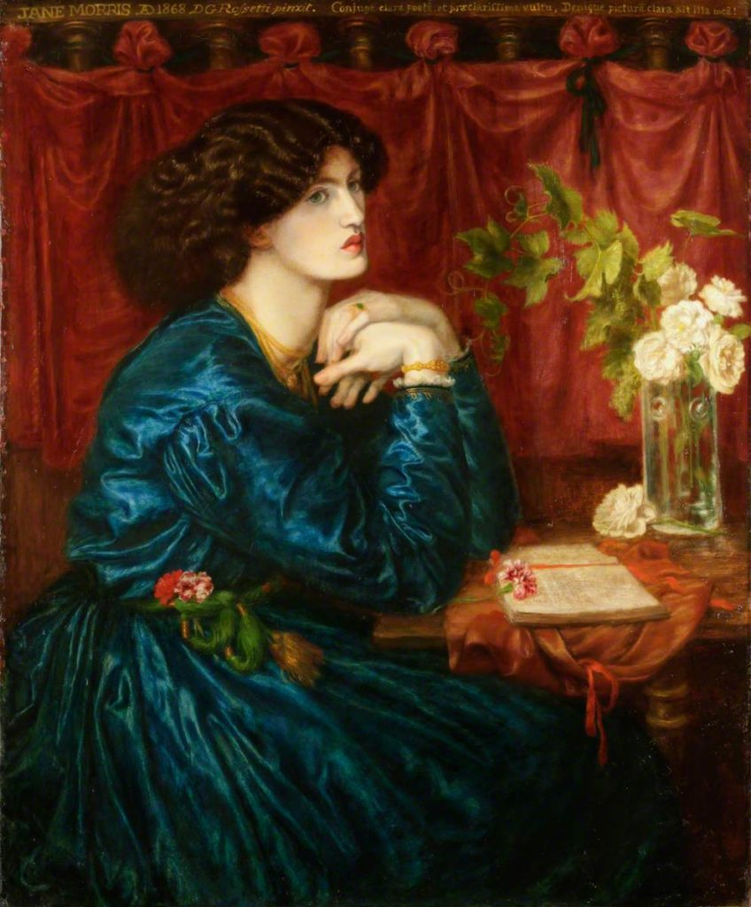 One of the most famouse Rossetti's portraits of Jane Morris showing her in a blue slik dress sitting leaning on the table