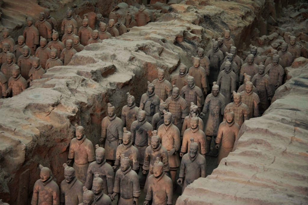 Many lines of Terracotta Army warriors warriors standing in the pit.