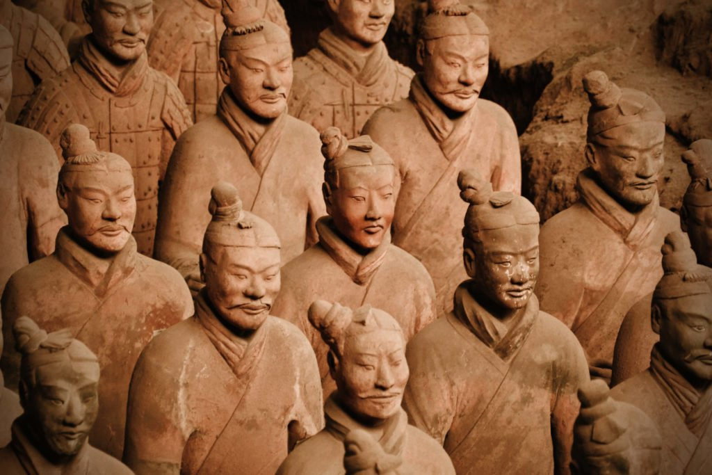 The Terracotta Army Warriors standing in rows, close-up.