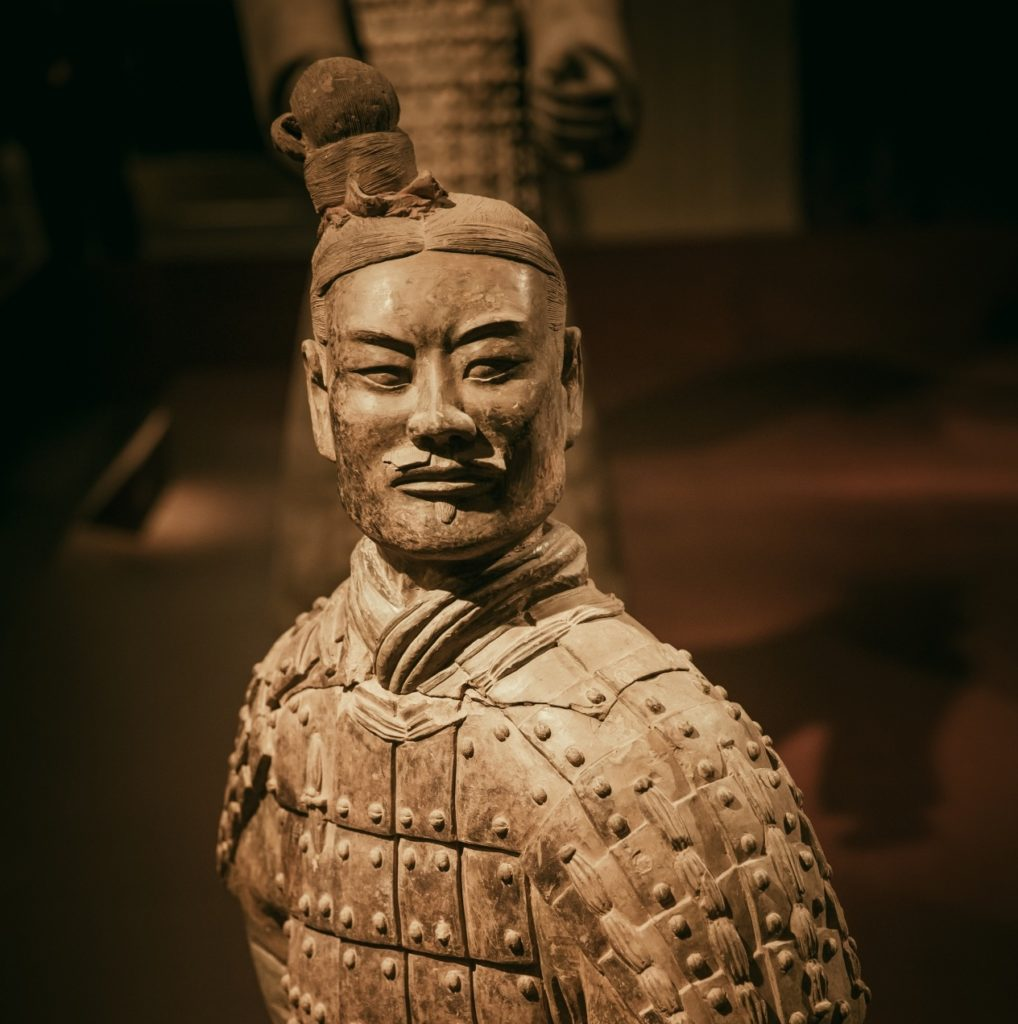 The Terracotta Army kneeling archer made to protect Qin Shi Huang in the next world, Emperor Qinshihuang's Mausoleum Site Museum, Shaanxi, China.