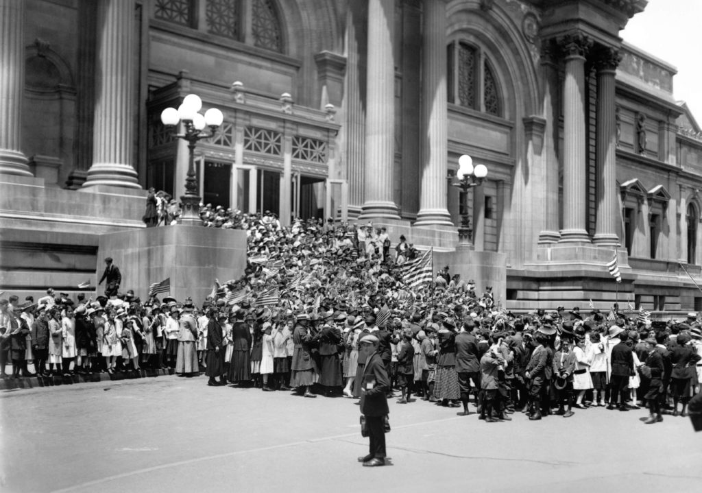 150 Years of the Met: The Met Fifth Avenue main entrance with students celebrating Flag Day on June 14, 1916_Image copyright The Metropolitan Museum of Art