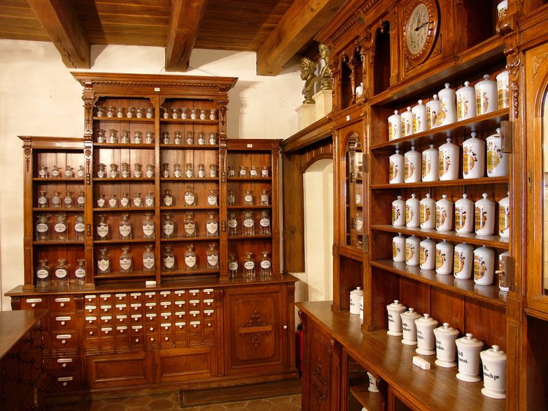 Wooden shelves with apothecary jars from the pharmacy museum in Sibiu
