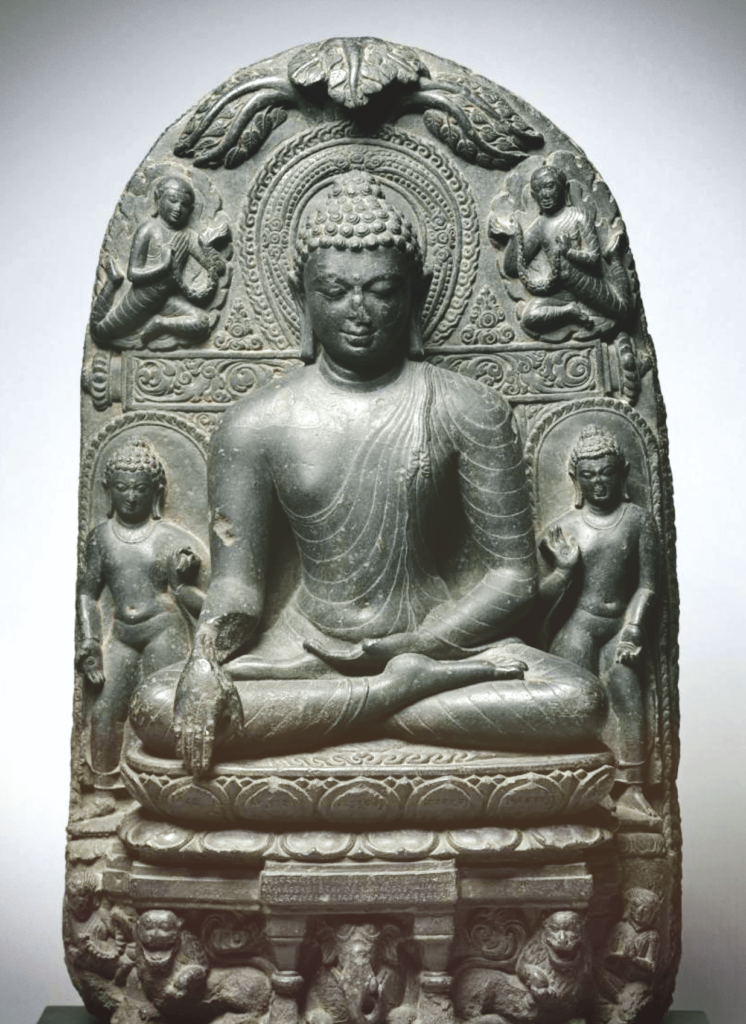 buddhist art, stone sculpture of the sitting buddha meditating with his eyes closed surrounded by other Buddha