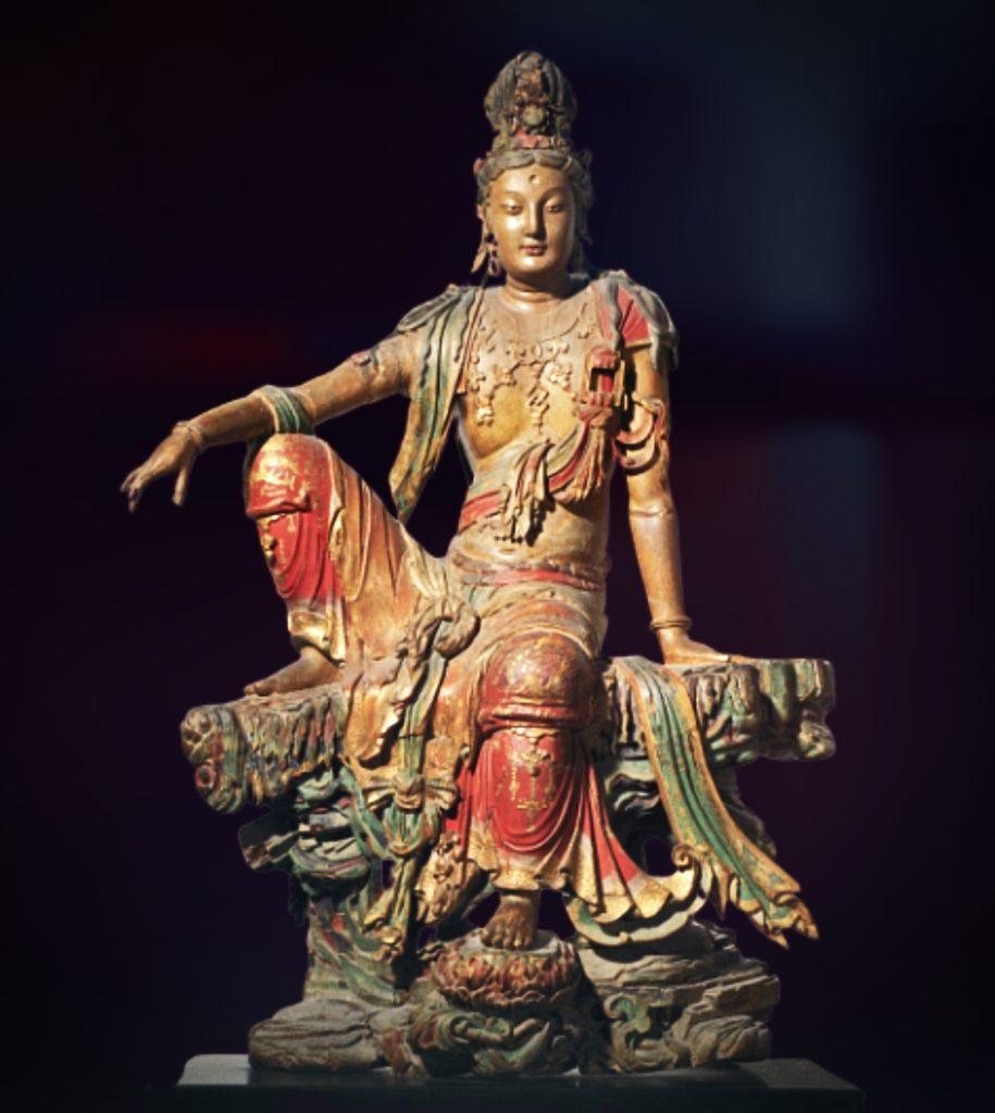 wooden sculpture of a sitting deity bodhisattva avalokiteshvara