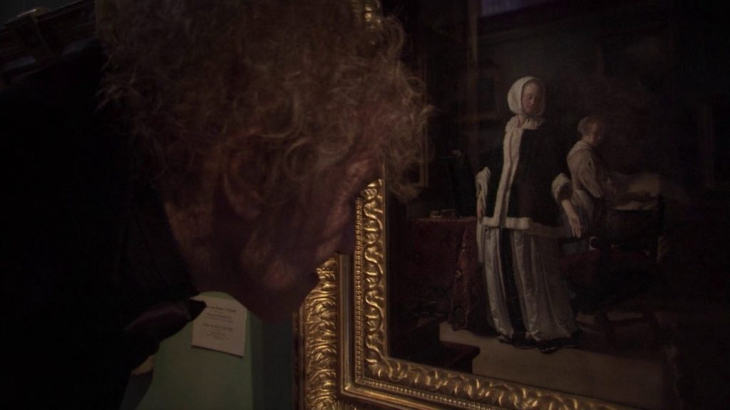 Still from the movie Russian Ark directed by Aleksandr Sokurov, depicting a man looking closely at a painting. Number one on the art-related films list.