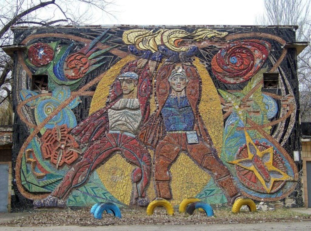 The mosaic panel by Viktor Zaretskyi named Prometheus. It portrays two minors.