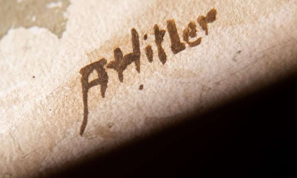Photograph of Adolf Hitler's signature on a watercolor supposedly created by him.