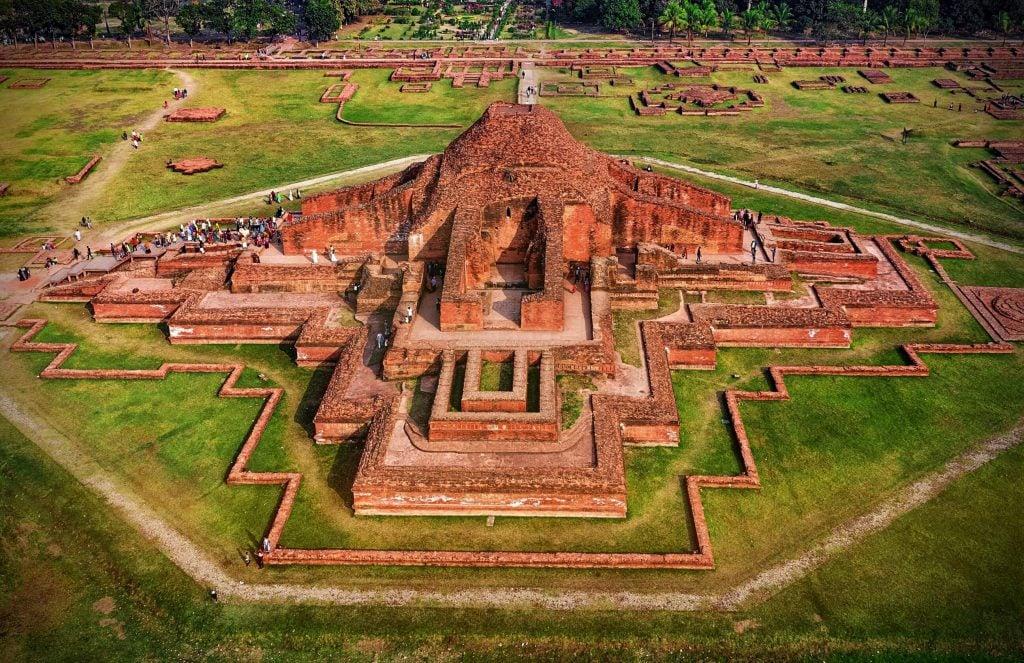 the aerial view of the ruins of the Buddhist monastic complex with the main tower in the center. Somapura Mahavihara mandala.