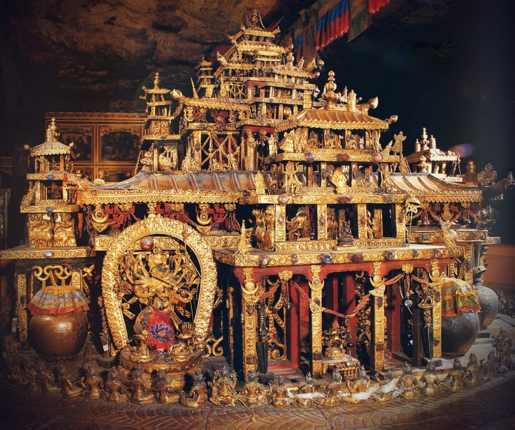 three-dimensional golden mandala with miniature deities at the Potala palace in Tibet