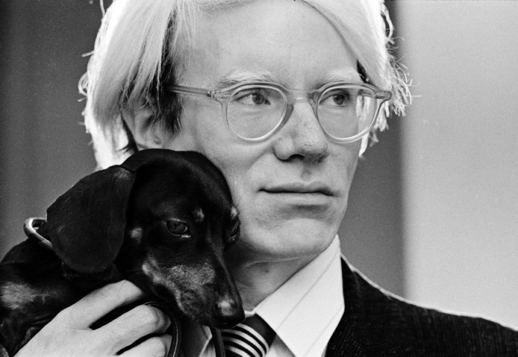 Andy Warhol with his miniature Dachshund, Archie.