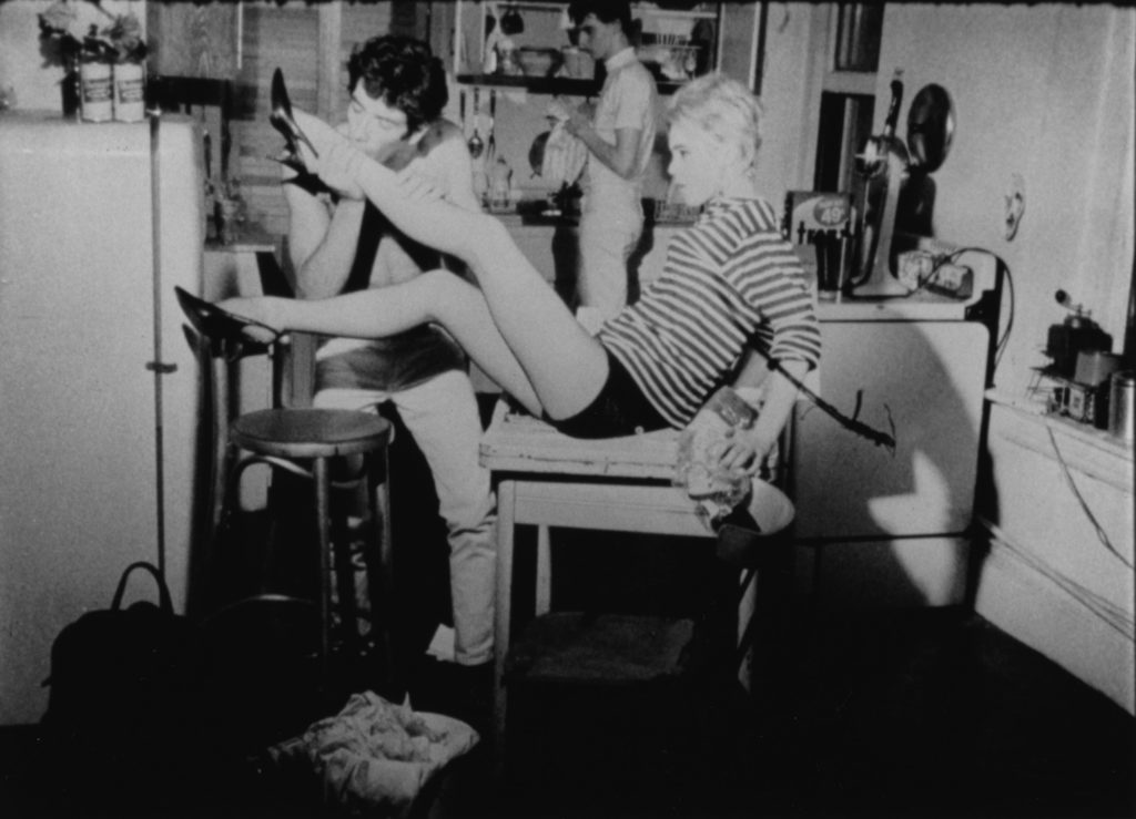 Kitchen Inspiration from Art History; Still photograph from Andy Warhol's film, Kitchen, showing the characters acting foolish in the kitchen.