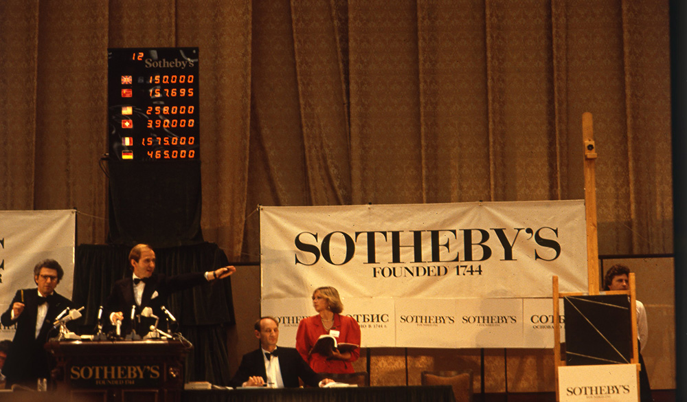 Auctioneer Simon de Pury at the rostrum, Moscow, 1988,