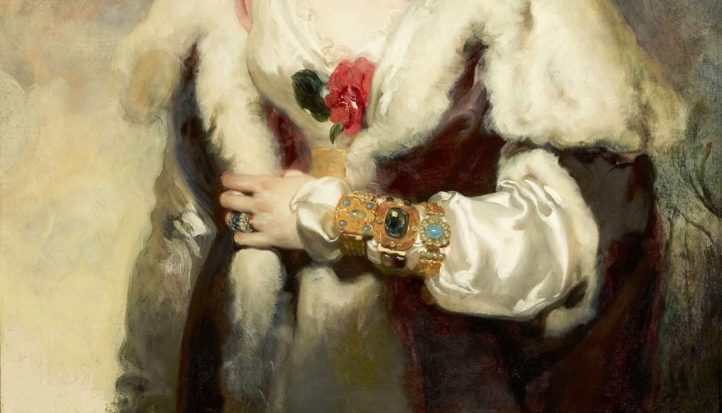 The woman in the fanciful dress, hat with red feathers is standing and looking directly at us. Detail with dress, camellia and jewelry are shown.