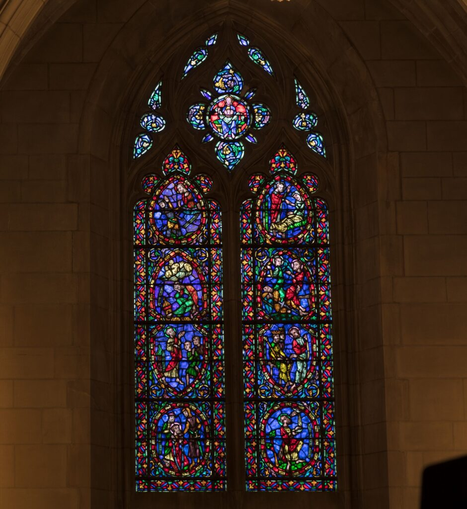 Stained-glass window, one of 77, in the Duke University Chapel on the campus of the university in Durham, North Carolina, USA