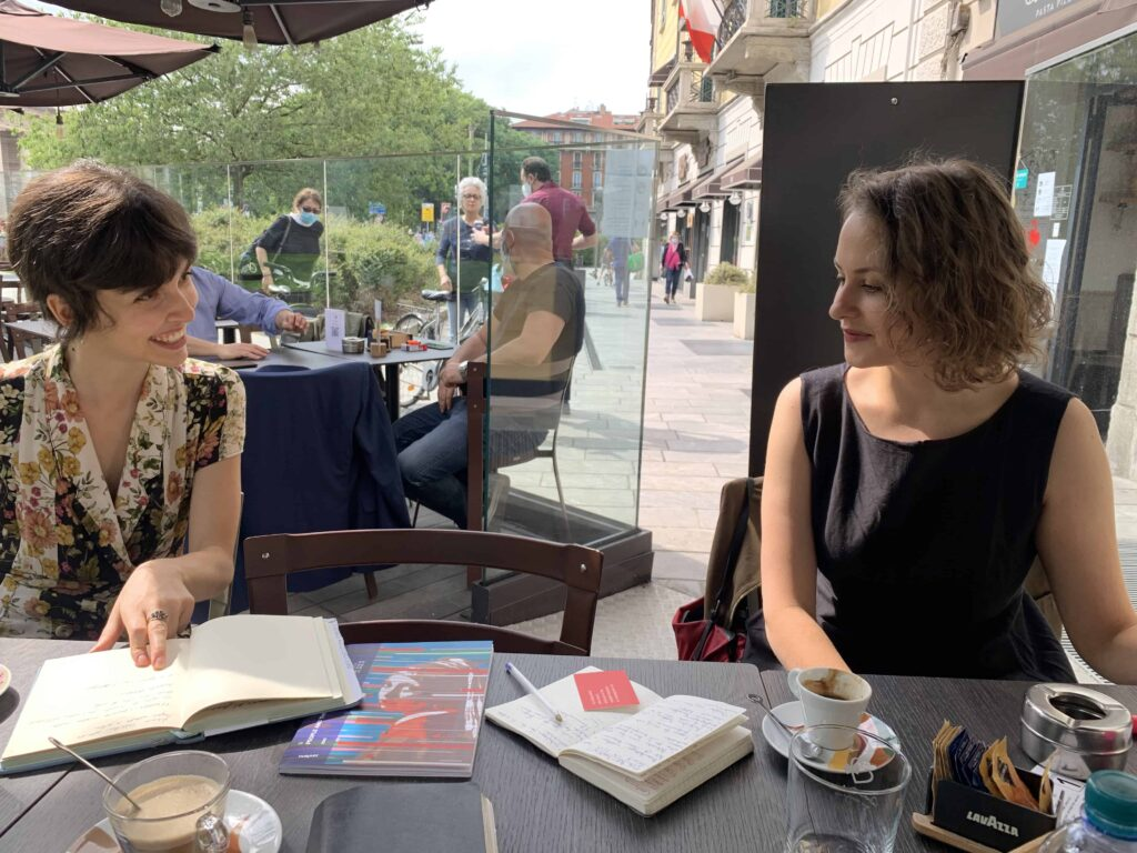 The REA! ARTE art fair: Picture of Pelin Zeytinci and Maria Myasnikova at a table of a cafe during a curatorial meeting.