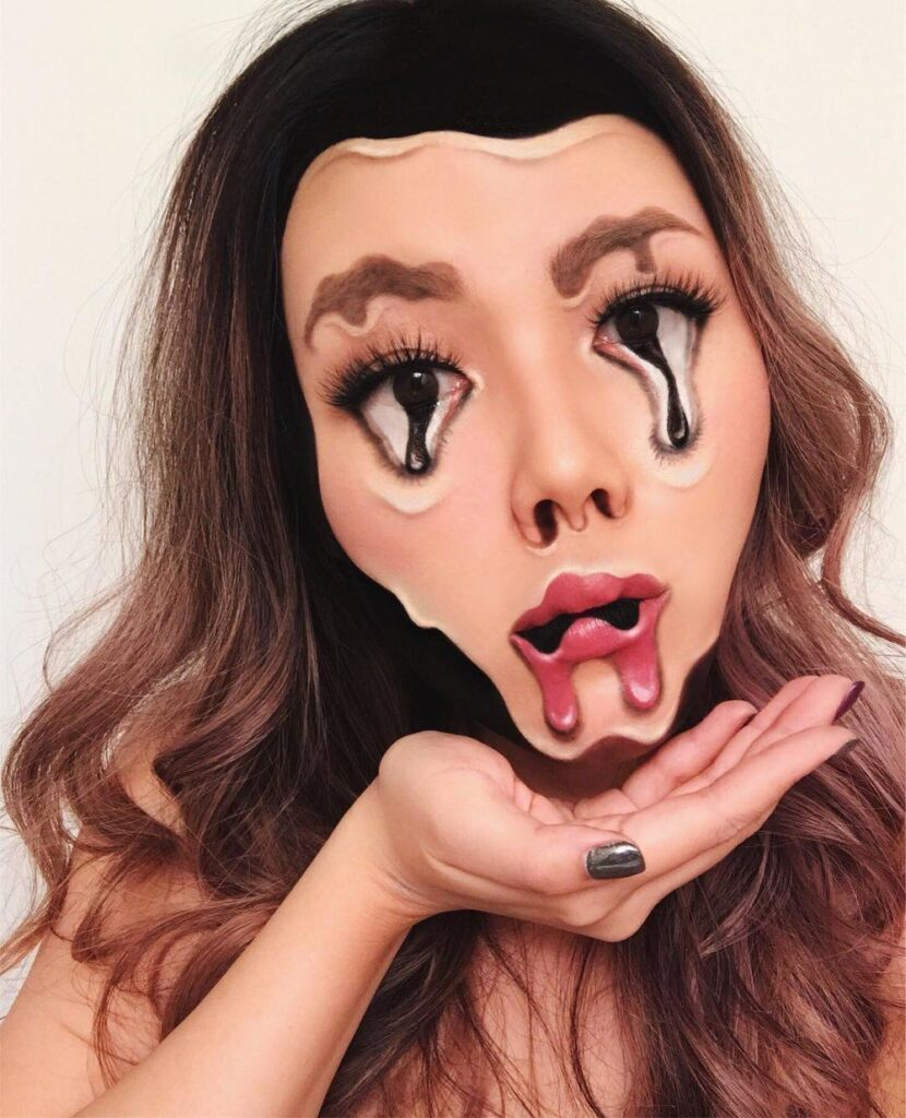 Makeup inspired by art. Makeup artist Mimi Choi is famous for creating optical illusions. This one reminds us of Dali.