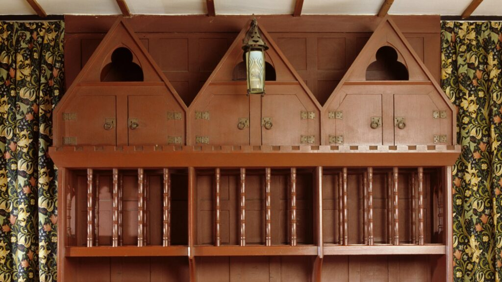 Arts and Crafts' Principles in Interior Design: Philip Webb Dragon Blood Red Dresser with William Morris curtain, at the Red House