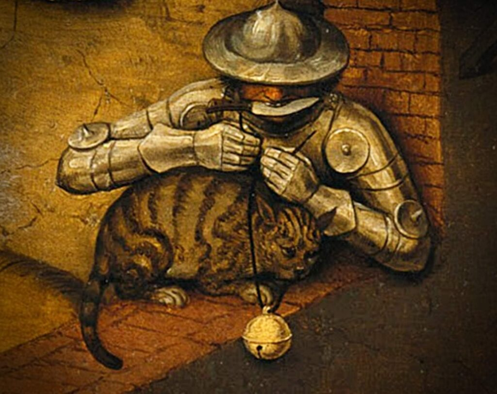 Spot a cat! Cats hidden in famous paintings: Pieter Bruegel the Elder, Netherlandish Proverbs the close-up of the man in armor and knife in his teeth trying to hang a bell on the cat