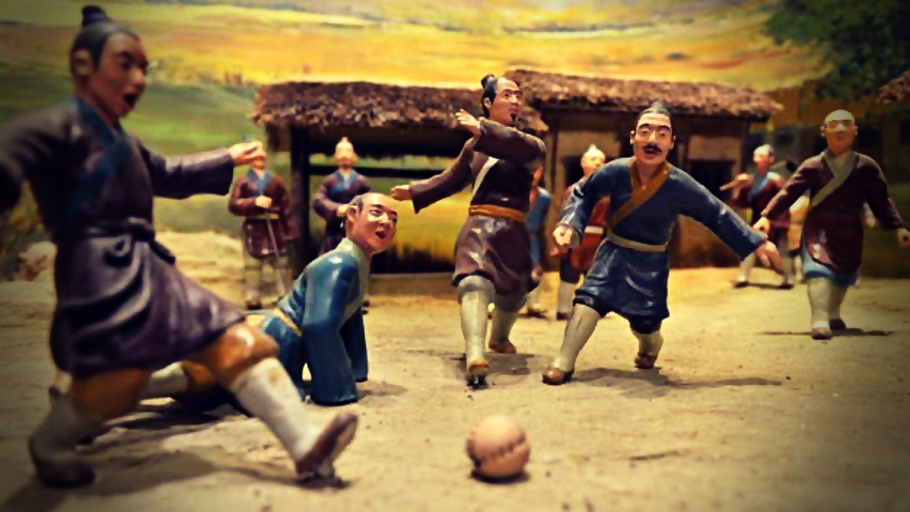 Modern Sports Played in Ancient China, the toy model of a cuju game with several players and a ball in the game
