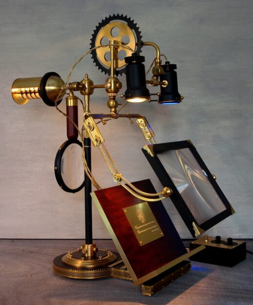 Art Donovan, The Ferryman, two-sided lamp for researcher and assistant, U.V. bulb, adjustable table, magnifiers, mahogany, brass.