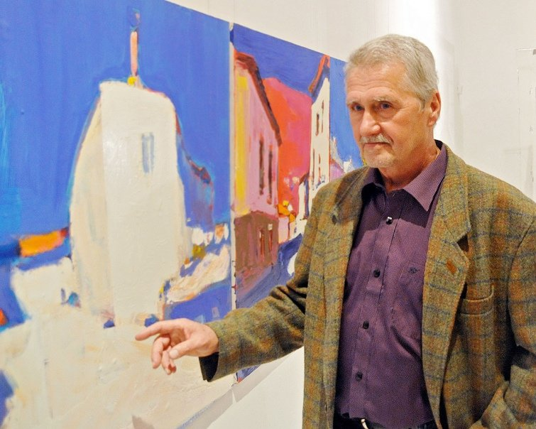 The photo of the Ukrainian artist Anatoliy Kryvolap in front of his painting.; Anatoliy Kryvolap