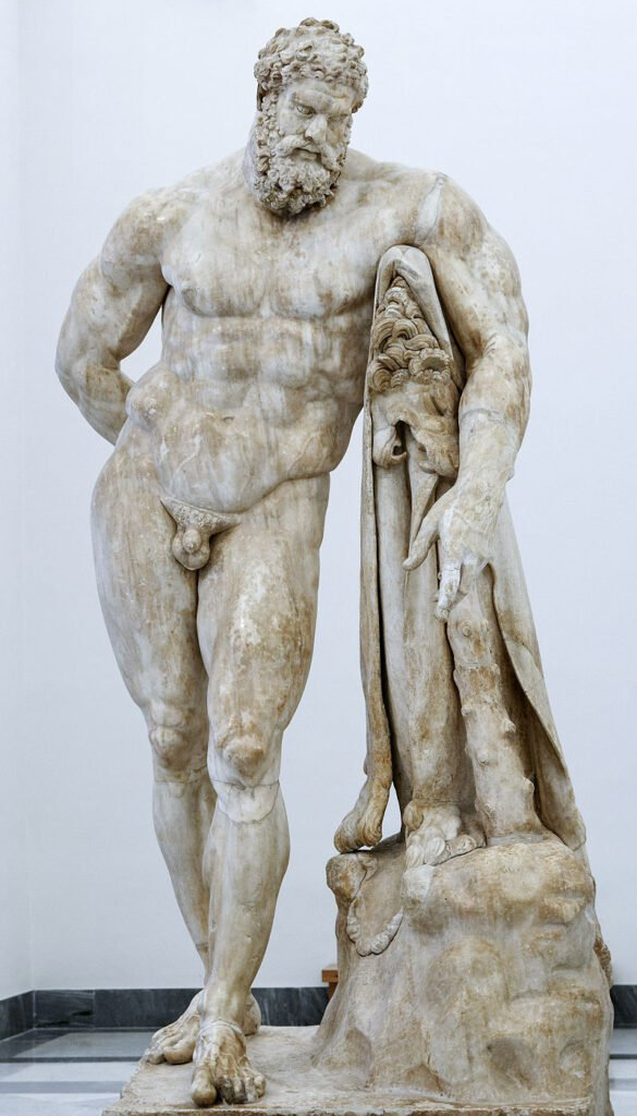 This is an ancient marble sculpture of a The Farnese Hercules from c. 216 CE. It is displayed at The National Archaeological Museum of Naples