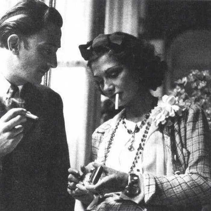 The Friendship of Salvador Dali and Coco Chanel. Salvador Dali and Coco Chanel sharing a cigarette, 1938. Pinterest.