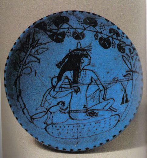 Tattoos history, art & culture: Blue bowl showing a musician with the deity Bes tattooed on her thigh