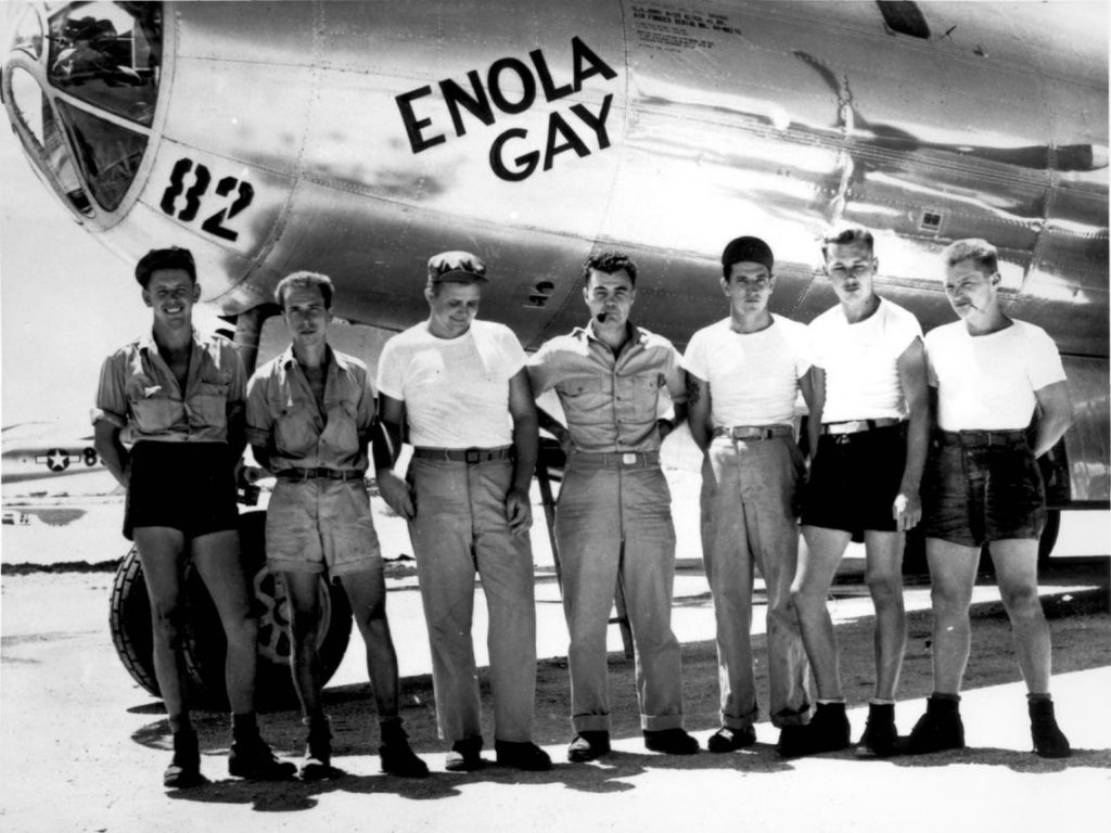 """The ground crew of the B-29 """"Enola Gay"""" which dropped the atomic bomb """"Little Boy"""" on Hiroshima, Japan. Col. Paul W. Tibbets, the pilot, is in the center. Photo courtesy of the Robert F. Dorr Collection."""