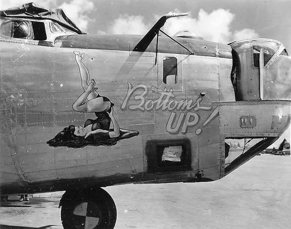 """Pinup Nose Art """"Bottoms up"""" on the B-24  Liberator. Source: www.airplanenoseart.com."""