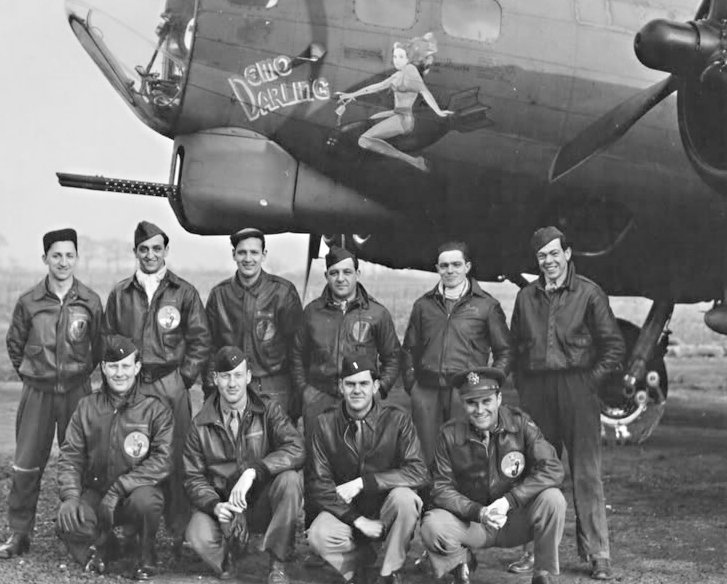 """The whole aircrew in front of the B-17 """"Demo Darling"""" bomber, 323 Bomb Squadron, 1944."""