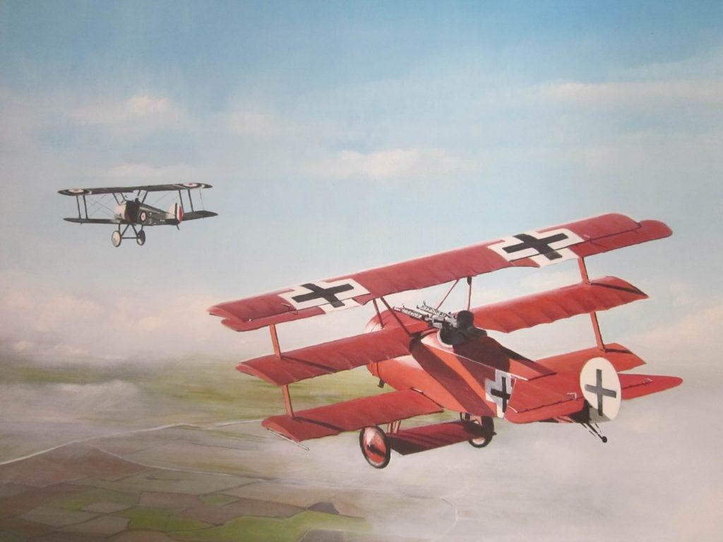 """Manfred von Richthofen """"Red Baron"""" in his Red painted Fokker Dr1 Dreidecker. Source: www.aviationartz.wordpress.com."""