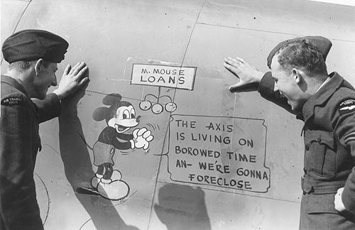 Two Royal New Zealand Air Force (RNZAF) Air Training Corps (ATC) cadets viewing the Mickey Mouse Nose Art on Lockheed Ventura fuselage, 1943.