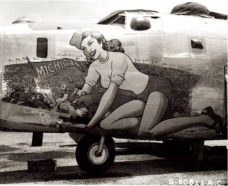 """Nose art featured on the Liberator B-24J known as """"Michigan"""". The mural was the creation of the well-known commercial artist, Sarkis Bartigian, who was a prolific nose art painter."""