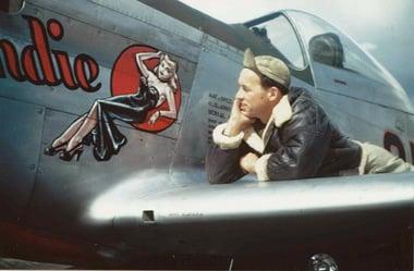 "Don Allen admires his handiwork as a ""nose art"" artist of World War II, credit: Whirlwind Productions."